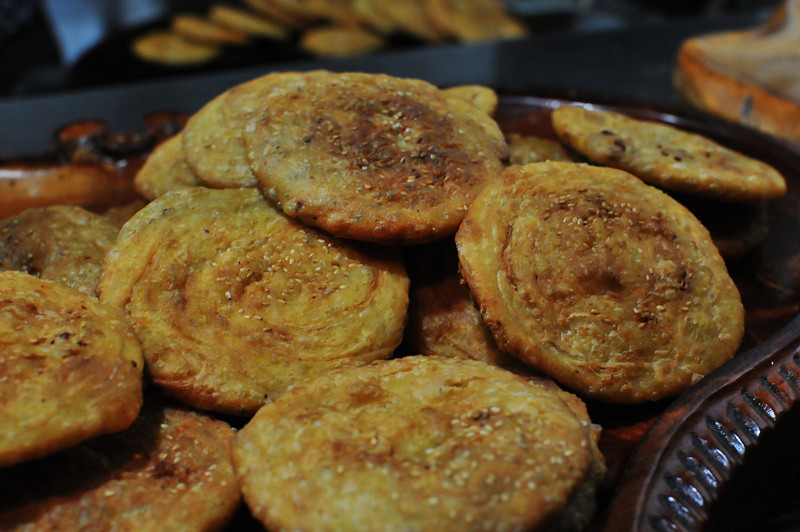 photo of fried flatbread cakes with sesame seeds